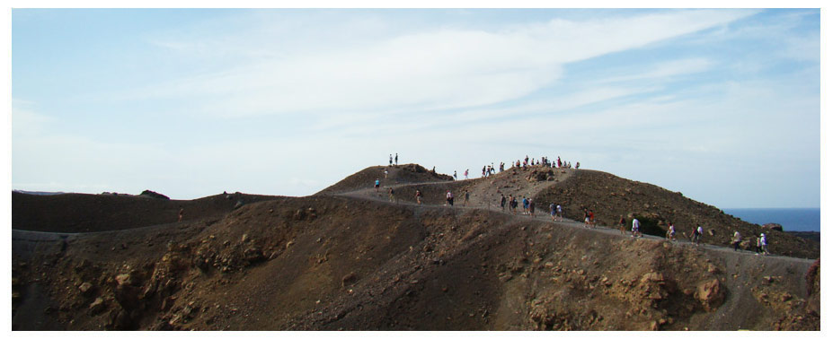 The Santorini volcano is the reason behind the islands unique shape and formation. Today, visitors to Santorini can take a cruise over to the small volcano islet that sits in the middle of the caldera and take a walk around an active volcano